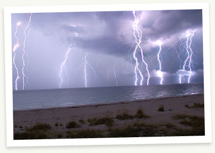 Lighting must hate the ocean!  Hope nobody is swimming right there.