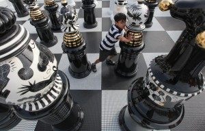 Kid playing Giant Chess